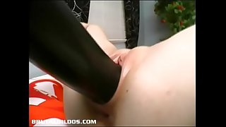 Vocal amateur yells loudly from a cruel dildo fucking